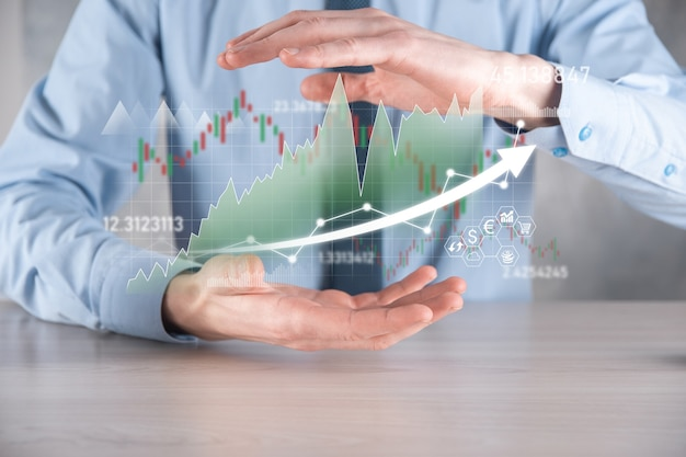 Businessman hold sales data and economic growth graph chart. business planning and strategy. analysing trading of exchange. financial and banking. technology digital marketing.profit and growing plan.