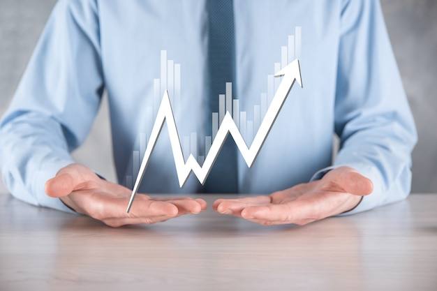 Businessman hold sales data and economic growth graph chart. business planning and strategy.