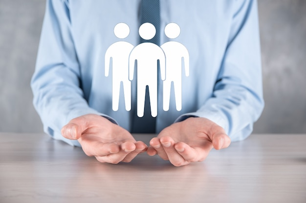Businessman hold teamwork icon. building a strong team. people icon. human resources and management concept. social networking, assessment center concept, personal audit or crm concept.