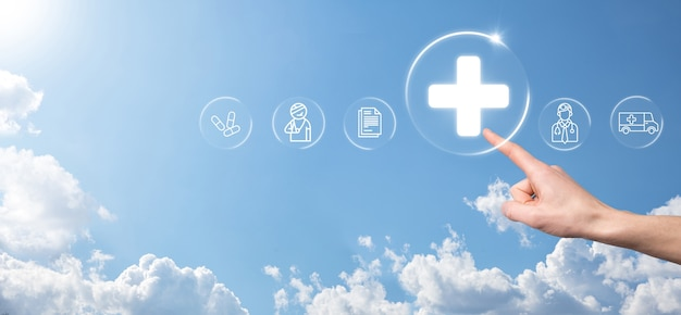 Businessman hold virtual plus medical network connection icons. covid-19 pandemic develop people awareness and spread attention on their healthcare.doctor,document,medicine,ambulance,patient icon.