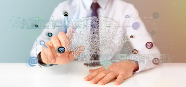 Businessman holding a 3d rendering artificial intelligence concept with a brain and app