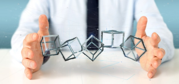 Businessman holding a 3d rendering blockchain cube isolated