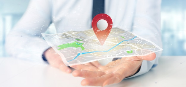 Businessman holding a 3d rendering pin holder on a map
