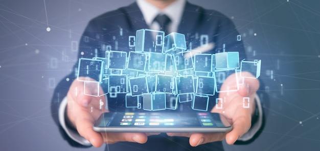 ブロックチェーンキューブとバイナリデータの3 dレンダリングの雲を保持している実業家