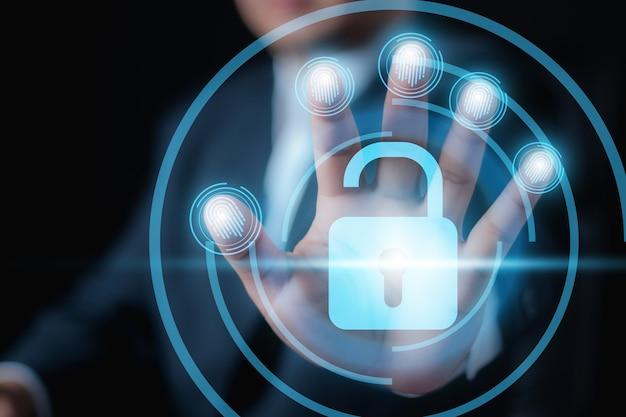 잠금 해제를 위한 디지털 지문 식별을 들고 있는 사업가 지문 스캔은 생체 인식 비즈니스 기술 안전 인터넷 개념으로 보안 액세스를 제공합니다.
