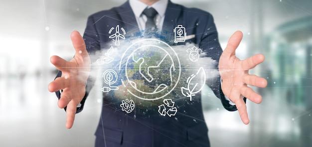 Бизнесмен держа глобус мира окружая значками экологичности и переводом соединения 3d