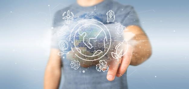 Бизнесмен держит глобус окружающий иконами экологии и связи