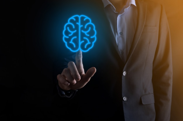 Businessman holding abstract brain and icon tools, device, customer network connection communication on virtual , innovative development future technology, science, innovation and business concept.