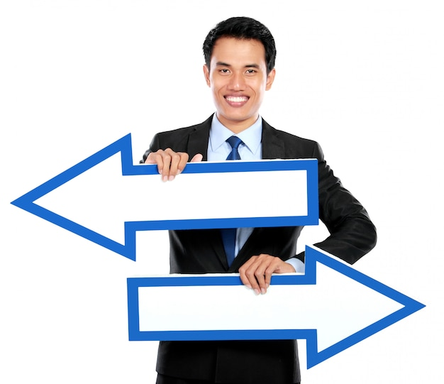 Businessman holding arrow in hand
