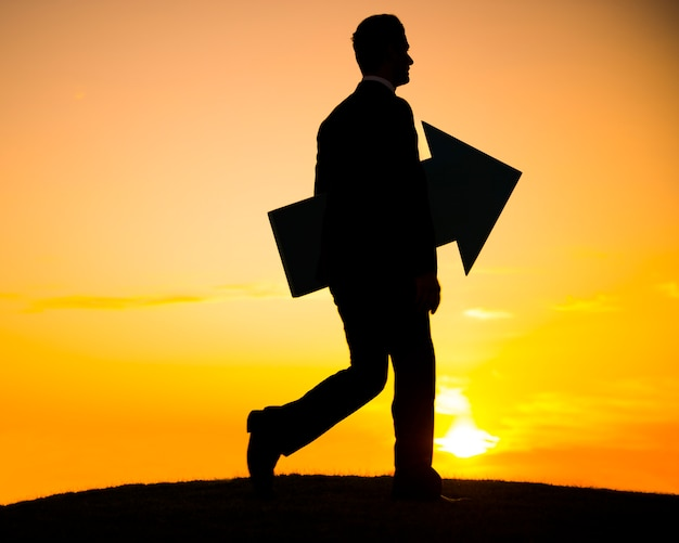Businessman holding the arrow and keep walking