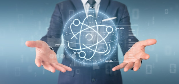 Businessman holding an atom icon surrounded by data