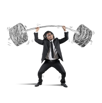 Businessman holding barbell con dumbells