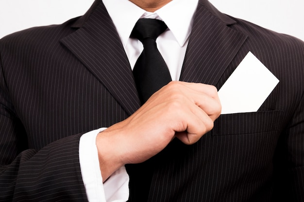 Businessman holding a blank business card