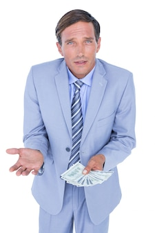 Businessman holding bribe