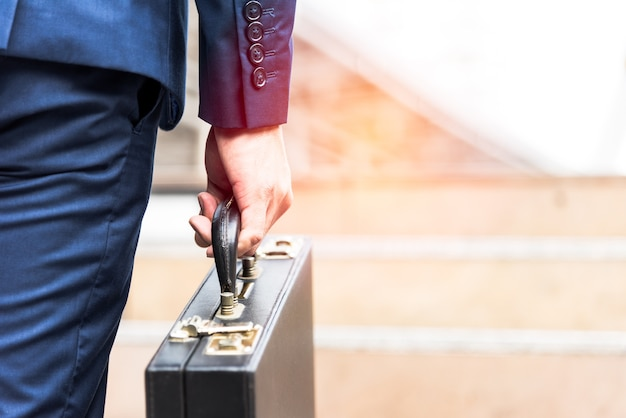 Businessman holding briefcase and going to work