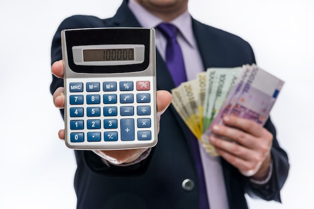 Businessman holding calculator and euro banknotes closeup