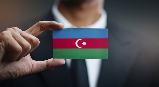 Businessman holding card of azerbaijan flag