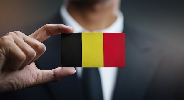 Businessman holding card of belgium flag