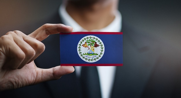 Businessman holding card of belize flag