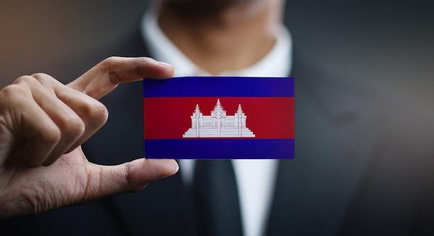 Businessman holding card of cambodia flag