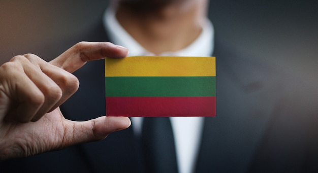 Businessman holding card of lithuania flag