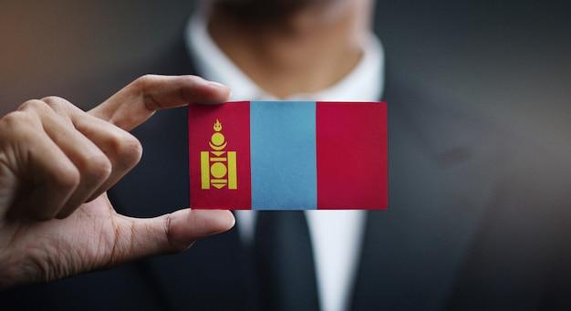 Businessman holding card of mongolia flag