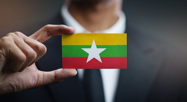 Businessman holding card of myanmar flag