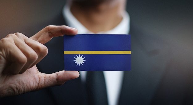 Businessman holding card of nauru flag
