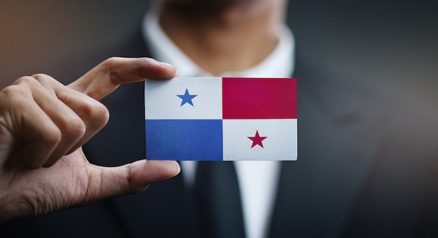 Businessman holding card of panama flag
