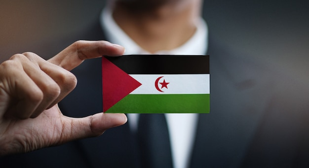 Businessman holding card of sahrawi flag