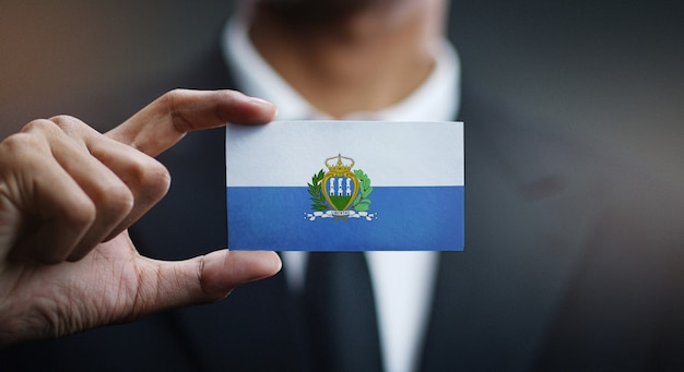 Businessman holding card of san marino flag