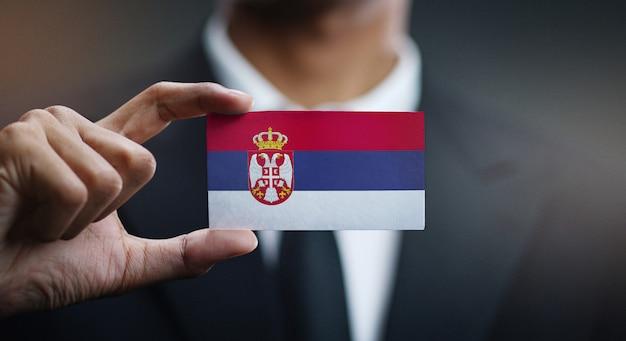 Businessman holding card of serbia flag