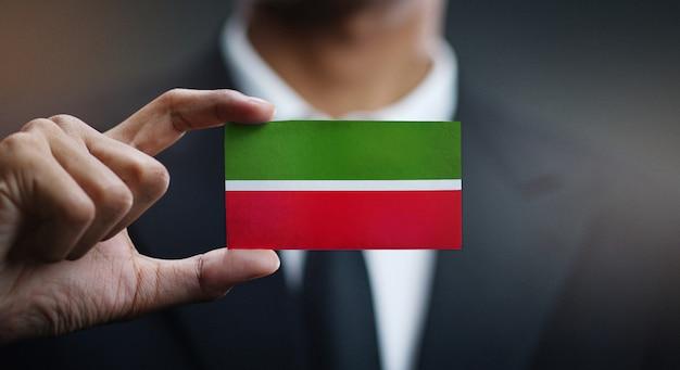 Businessman holding card of tatarstan flag
