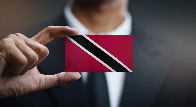 Businessman holding card of trinidad and tobago flag