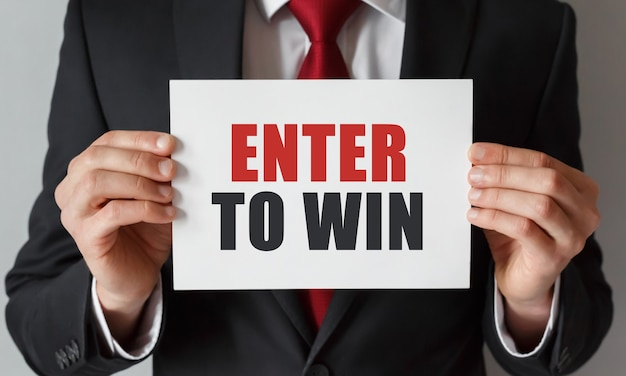 Businessman holding a card with text enter to win
