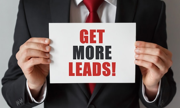 Businessman holding a card with text get more leads