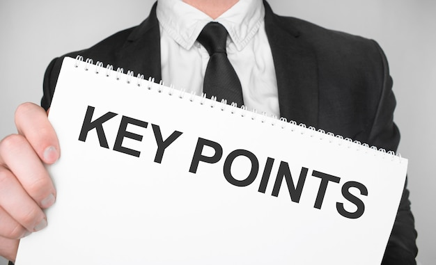 Businessman holding a card with text key points