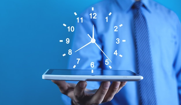 Businessman holding clock. business time management