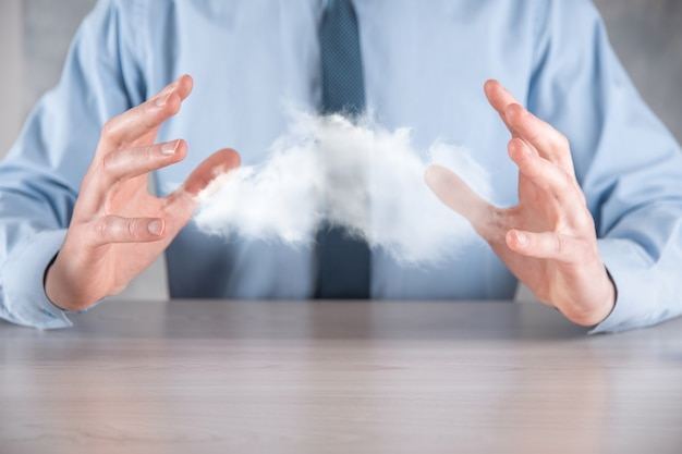 Businessman holding cloud.cloud computing concept, close up of young business man with cloud over his hand.the concept of cloud service.