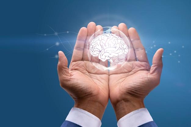 창의적인 사고 아이디어와 혁신의 개념 두뇌의 디지털 이미지를 들고 사업가