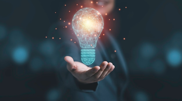 Businessman holding drawing glowing lightbulb, creative thinking ideas and innovation concept.