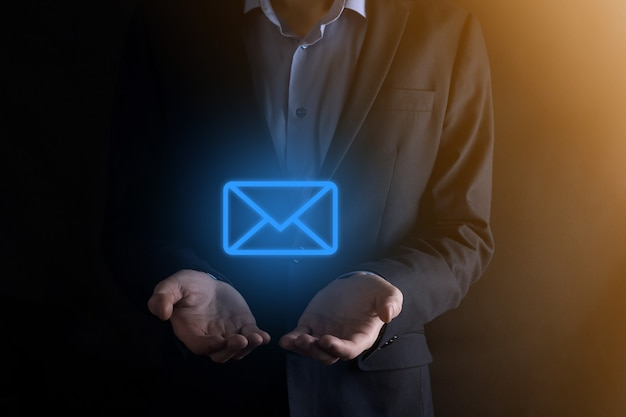 Businessman holding e-mail icon