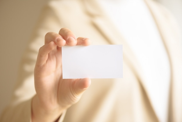 Businessman holding empty business card with copy space