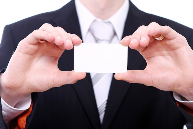 Businessman holding empty bussines card