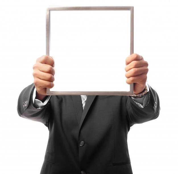 Businessman holding a frame with white wall texture