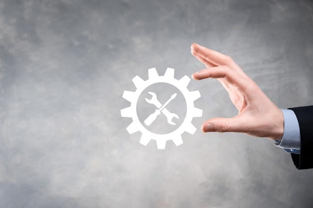 도구와 기어 아이콘을 들고 사업가 대상 초점 디지털 다이어그램, 그래프 인터페이스, 가상 ui 화면, 연결 netwoork의 gearing.concept.