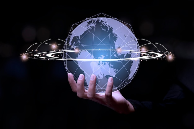 Businessman holding global network connection