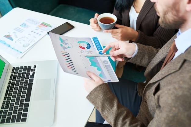 Businessman holding graphs