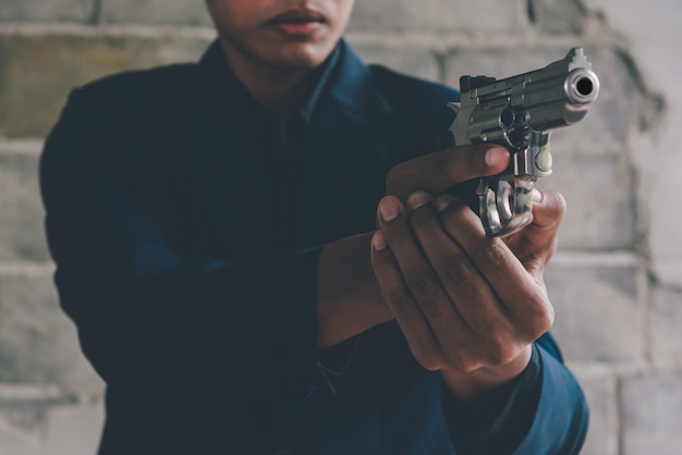 Businessman holding a gun to kill himself committed suicide