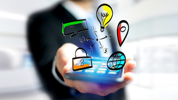 Businessman holding a hand drawn icon of business, multimedia and technology